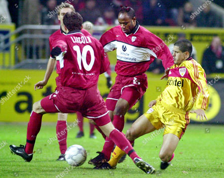 ADHEMAR Miroslav Klose, left, Cassio Soares Lincoln, 10, and Nigerian player Taribo West, center, of 1.FC Kaiserslautern, and Brazilian Ferreira Adhemar of VfB Stuttgart, right, fight for the ball during their first division soccer match in Kaiserslautern, western Germany