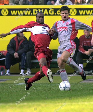 WEST RINK Nigerian Taribo West, left, of 1. FC Kaiserslautern fights for the ball with Paulo Rink of 1. FC Nuremberg, during their German first division soccer match Saturday, Feb. 16, 2002 in the Fritz-Walter Stadium in Kaiserslautern, western Germany