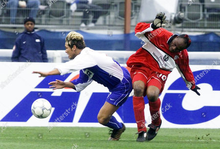 ALVES LINCOLN 1.FC Kaiserslauterns Taribo West, right, tackles Hertha BSC Berlins Alex Alves, from Brazil, left, in the penalty area during the German first league soccer match Hertha BSC Berlin vs. 1.FC Kaiserslautern in the Olympic Stadium in Berlin, Saturday, Feb. 23. 2002. After this tackle Berlins Marcelinho kicked the winning goal, 1-0 for Hertha BSC