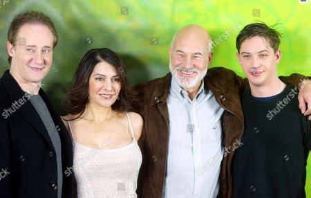 """SIRTIS U.S. actor Brent Spiner, who plays android """"Commander Data"""", Greek-born actress Marina Sirtis, who plays """"Commander Deanna Troy"""", Patrick Stewart, of Britain, who plays """"Captain Jean-Luc Picard"""" and British actor Tom Hardy, from left to right, pose during a photo-call to promote the new film """"Nemesis"""", the 10th film in the """"Star Trek"""" movie series in Berlin, . The latest """"Star Trek"""" movie will be screened in German cinemas from Jan. 16, 2003"""