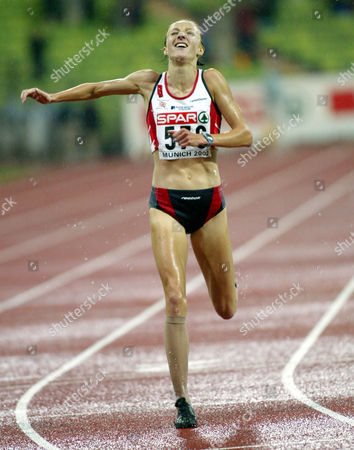 Stock Picture of RADCLIFFE British runner Paula Radcliffe crosses the finish line winning the title and setting up a new European record with 30:01:09 minutes at the European Athletics Championships in the Olympic Stadium in Munich, Germany
