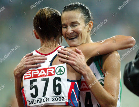 Stock Image of RADCLIFFE O'SULLIVAN British runner Paula Radcliffe, left, is hugged by Irish Sonia O'Sullivan after Radcliffe won the title and set up a new European record with 30:01:09 minutes at the European Athletics Championships in the Olympic Stadium in Munich, Germany