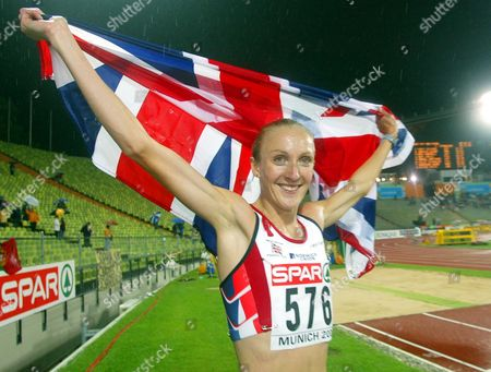 Stock Photo of Britain's Paula Radcliffe celebrates on her victory lap after winning the gold medal in the women's 10,000 meters during the European Athletics Championships in the Olympic Stadium in Munich, Germany