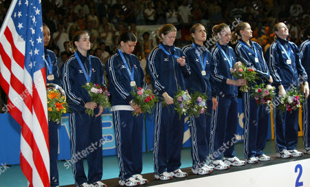 BACHMAN The U.S. volleyball team displays their silver medals during the winners ceremony after the final of the Women's Volleyball World Championships in Berlin on . Italy beat the U.S., 3-2, and won the world championships. U.S. players from left to right: Tara Cross-Battle, Jennifer Flynn, Stacy Sykora,Heather Brown, Sarah Noriega, Nancy Metcalf, Logan Tom and Elisabeth Bachman