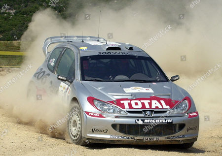 Britain's Richard Burns and his co-driver Robert Reid with their Ford Peugeot WRC 02 roar at Elatia special stage, central Greece, during the second day of the 49th Acropolis Rally, . Some 89 teams take part in the three-day rally covering 1,197 kilometers (748 miles) across southern and central Greece