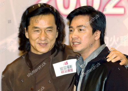 """CHAN TONG Hong Kong actor Jackie Chan, left, poses with film director Stanley Tong during a Media Asia news conference at a Hong Kong hotel . Media Asia, a film company based in Hong Kong, announced new movies for the 2002-2003 season. Chan will play a leading role in the movie """" Titanium Rain,"""" directed by Stanley Tong"""