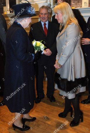 Queen Elizabeth meets Sly Bailey, chief executive of Trinity Mirror