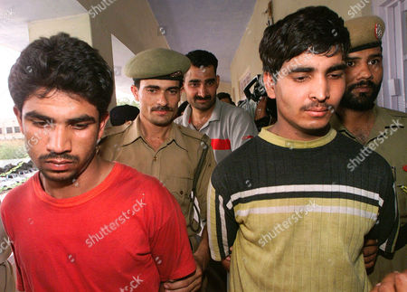 Zulfiqar, also known as Abu Jahad, right, and Zakir Hussain, left, suspected Pakistani terrorist members of the Islamic militant group Lashkar-e-Tayyaba, are presented to the media by police in Jammu, the winter capital of India's Jammu-Kashmir state, . Along with the two men, the police also presented a large amount of arms and ammunitions, including 2 AK-56 rifles, 3 pistols, 8 grenades, 130 detonators and 19 remote control devices, that had allegedly been in their possession