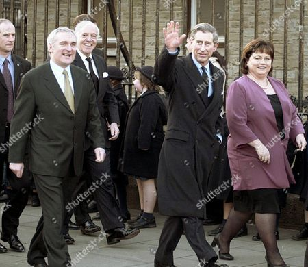 CHARLES Britain's Prince Charles waves to the crowd as he walks in Dublin, with Irish Prime Minister Bertie Ahern, left, and Deputy Prime Minister Mary Harney, right. They were on their way to the National Art Gallery of Ireland to view the new Millenium Wing