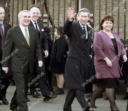 Britain's Prince Charles waves to the crowd as he walks in Dublin, with Irish Prime Minister Bertie Ahern, left, and Deputy Prime Minister Mary Harney, right. Prince Charles is expected to visit the scene of one of the Irish Republican Army's most high-profile assassinations _ the 1979 slaying of Charles' great-uncle Lord Mountbatten _ during an official visit next month to Ireland, it was reported on Tuesday, April, 21, 2015