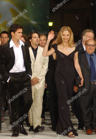 """MOLTENI From left, actor Jay Rodan, Oliver Martinez, boyfriend of American actress Mira Sorvino, third from left, and actor Luis Molteni arrive at the presentation of their movie """"The Triumph of Love"""" at the Venice Film Festival in Venice, northern Italy"""