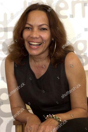 "Cuban actress Luisa Maria Jimenez smiles prior to the presentation of ""Rosa La China"" by Chilean director Valeria Sarmiento in Venice, northern Italy"