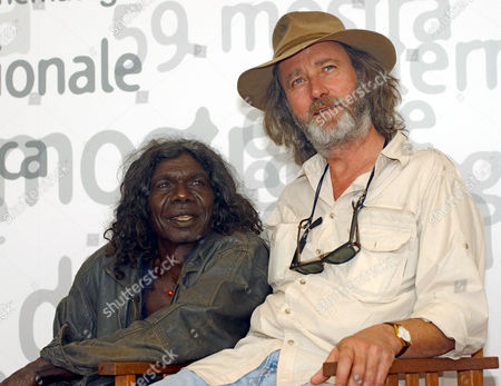 """Australian actor David Gulpilil, left, and Dutch-Australian movie director Rolf De Heer smile during a photocall in Venice, Italy, . Their movie """" The Tracker"""" is in competition at the 59th Venice Film Festival"""