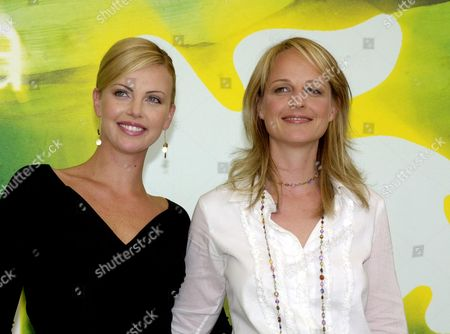 """Stock Photo of THERON South African actress Charlize Theron, left, and U.S. actress Helena Hunt during a photocall, at the Venice Lido, to present their movie """"The Course of the Jade Scorpion"""" by Woody Allen in competition for the Golden Lion at the 58th Venice film festival"""