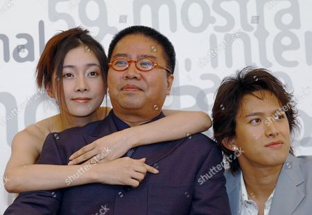 """From left, Yang Hee Kim, movie director Fruit Chan and actor Abe Tsuyoshi, all from Hong Kong, during a photocall in Venice, Italy, . Their movie """"Ren Min Gong Che"""" (Public Toilet) will be presented out of competition at the 59th Venice Film Festival"""