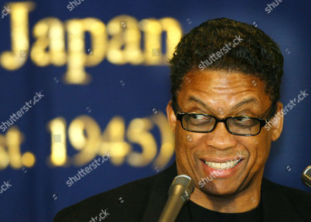 """HANCOCK Legendary jazz pianist Herbie Hancock speaks at a press luncheon in Tokyo . Hancock is in Japan to perform two shows with jazz greats Michael Brecker and Roy Hargrove called """"Directions in Music."""" He is also making plans to produce this year's Tokyo Jazz Festival 2003 on Aug 23 and 24"""