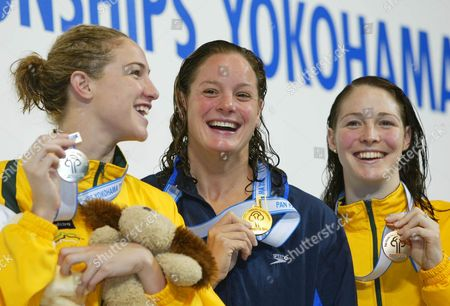 BENKO GRAHAM ROONEY EAmerican Lindsay Benko, center, smiles with the gold medal of the women's 200-meter freestyle final as she is joined by silver medalist Elka Graham, left, and bronze medalist Giaan Rooney, both of Australia, in the Pan Pacific Swimming Championships in Yokohama, south of Tokyo, Tuesday, Aug.27, 2002. Benko won the race with a time of 1: 58.74