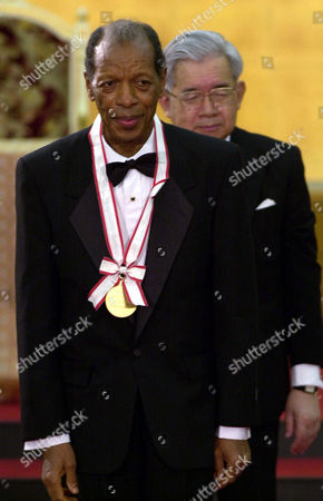 COLEMAN HITACHI American jazz player Ornette Coleman smiles after being awarded Praemium Imperiale in music category during the 13th awarding ceremony in Tokyo . Coleman and four other recipients of the World Culture Award in memory of late Prince Takamatsu, the younger brother of late Emperor Showa and father of Prince Hitachi, seen behind Coleman, received 15 million yen (some $123,000) each