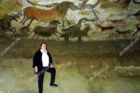 """AUEL Bestselling author Jean Auel poses in the famous painted and engraved Lascaux-2 cave, in Montignac, southwestern France, . Auel is back after a 12-year absence with the fifth book in her Earth's Children series,""""The Shelters of Stone"""", and chose the caves to launch her novel settled in Ice Age France"""
