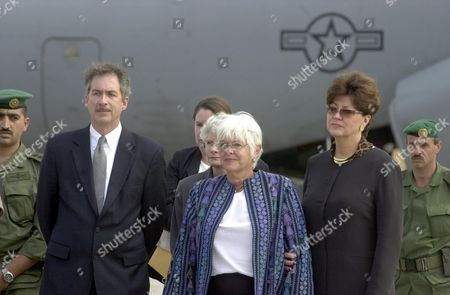 BURNS FOLEY WAGNER U.S Assistant Secretary of State William Burns, left, Virginia Foley widow of Laurence Foley, center, and Foley's boss Toni Chistiansen-Wagner, right, stand at the Marka Air Base in the Jordanian capital Amman on . Foley, who worked for the U.S. Agency for International Development, was killed by a lone gunman as he apparently headed for his car, parked in front of his house, in Amman Monday. A U.S. military plane will carry Foley's body to the Andrews Air Force Base in Maryland
