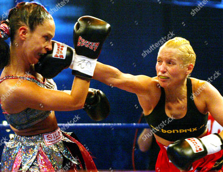 LANG WEICKENMEIER German boxers Daisy Lang, left, and Silke Weickenmeier fight for the featherweight GBU World Championship title at the Grugahalle Hall in Essen, western Germany, . The match ended in a draw