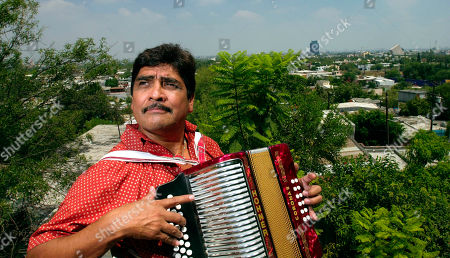 Mexican accordion player Celso Pina plays on the roof of his home in Monterrey, Mexico,. Pina is called the accordion rebel _ a Mexican who plays Colombian vallenato music in a city that has little in common with the South American nation other than Spanish, drug smuggling and a collective love of the accordion. He will go up against Colombian vallenato superstar Carlos Vives for a Latin Grammy Wednesday, Sept. 18, 2002 at the Kodak Theatre in Hollywood