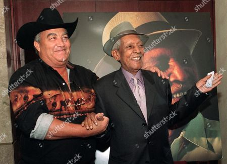 SEGUNDO OCHOA Cuban musicians Compay Segundo, 94, right, and Eliades Ochoa, 65, pose at a press conference in Mexico City . The two, who won the 1997 Grammy for best foreign album with the Buena Vista Social Club, will perform a charity concert this Friday in Mexico City