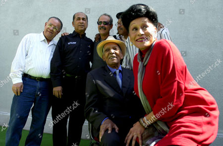 CLUB Members of the Cuban band Buena Vista Social Club pose for a photo prior to a press conference in Mexico City, Mexico . From left, Guajiro Mirabal, Cachaito Lopez, Barbarito Torres, Juan de Marcos, Compay Segundo, seated, and Omara Portuondo. The group is in Mexico City for the second time in five months to give a concert