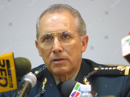 Defence Secretary Clemente Vega Garcia speaks at a press conference announcing the arrest of drug trafficker Benjamin Arellano Felix in Mexico City. Soldiers raided a house in central Mexico early Saturday and captured Felix, alleged leader of Mexico's bloodiest drug gang