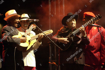 CLUB Cuban group Buena Vista Social Club from left, Compay Segundo, Barbarito Torres, Eliades Ochoa and Juan de Marcos perform at Revolution Plaza Sunday 2, 2002, in Mexico City. The group played a free open air concert