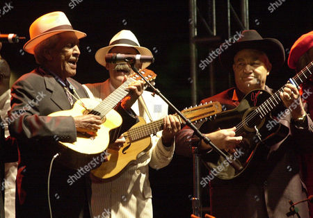 CLUB Cuban group Buena Vista Social Club from left, Compay Segundo, Barbarito Torres and Eliades Ochoa perform at Revolution Plaza Sunday 2, 2002, in Mexico City. The group played a free open air concert