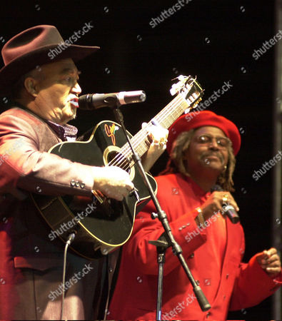 CLUB Cuban group Buena Vista Social Club's Eliades Ochoa, left, and Juan de Marco perform at Revolution Plaza Sunday 2, 2002, in Mexico City. The group played a free open air concert