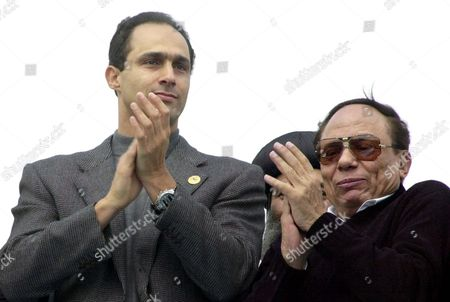 Egyptian President Hosni Mubarak's eldest son, Gamal, left, and Egyptian comedian Adel Emam, right, applaud crowds during an anti-war demonstration organized by the ruling Egyptian National Democratic party in Cairo