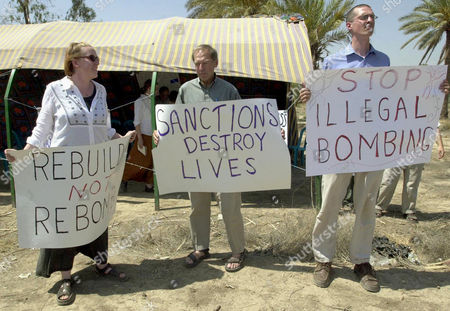 Phil Steger from St. Paul, Minnesota, right, John Maus, center, from Bloomington, Minnesota, and Meg Novac from Minneapolis, protest outside a United Nations office in Baghdad, Iraq . Six American activists opposed to U.N. sanctions and U.S. war threats against Iraq started a one day fast to mark the 12th anniversary of U.N. sanctions that crippled Iraq's economy