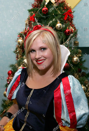 Eliza Taylor-Cotter helps switch on the Weymouth Christmas lights. She stars in 'Snow White' at Weymouth Pavilion