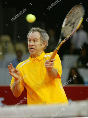 "MC ENROE US tennis legend John McEnroe, hits the ball during The ATP Senior tour of Champions, the ""Tamoil Legends of Monte Carlo"" Pro-Celebrity tennis tournament at Grimaldi Forum, in Monaco"