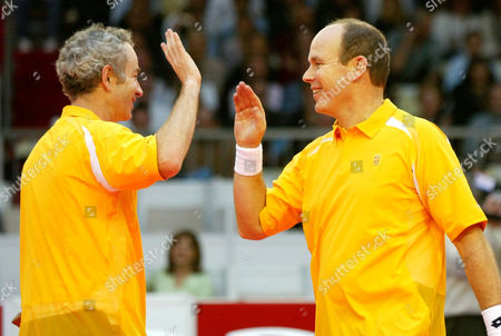 """MCENROE ALBERT US tennis legend John McEnroe, left, celebrates with Prince Albert of Monaco, right, as they play in the doubles together during the ATP Senior Tour of Champions """"Tamoil Legends of Monte Carlo"""" Pro-Celebrity tennis tournament at Grimaldi Forum, in Monaco"""