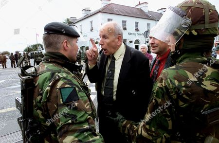 MURPHY Sinn Fein's Mick Murphy argues with British soldiers during a parade by the Ancient Order of Hibernians, a Catholic group, through the mainly Protestant town of Kilkeel in County Down, Northern Ireland . A heavy deployment of British soldiers and Royal Ulster Constabulary kept Catholic and Protestants apart as the parade passed by peacefully