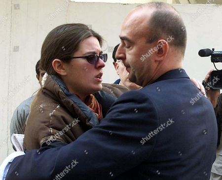 FUENTES Monica Fuentes, left, wife of Spanish journalist Julio Fuentes who was killed in Afghanistan, is comforted by unidentified person at local hospital in Peshawar, Pakistan on . The bodies of four international journalists, Harry Burton of Australia and Azizullah Haidiri of Afghanistan, working with Reuters, Maria Cutuli of Italian newspaper Corriere della Sera and Julio Fuentes of the Spanish daily El Mundo, arrived in Pakistan. They were ambushed last Monday by unidentified gunmen on their way to Kabul from Jalalabad in Afghanistan