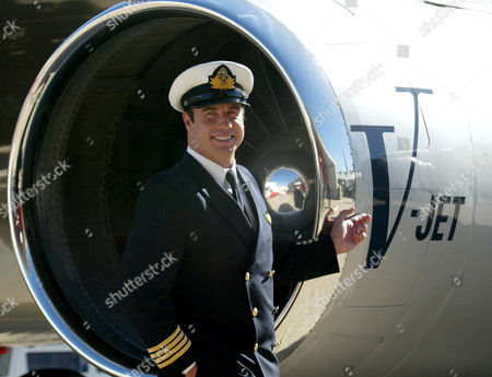 Actor John Travolta stands next to one of the engines of his personal jet after he arrived in Sydney, Australia on the Spirit of Friendship world tour for Qantas airline. The 55-year-old actor and avid pilot plans to fly one of his private jets from Florida to Haiti bringing relief supplies on Monday night Jan. 25, 2010, according to Travolta's spokesman, Paul Bloch