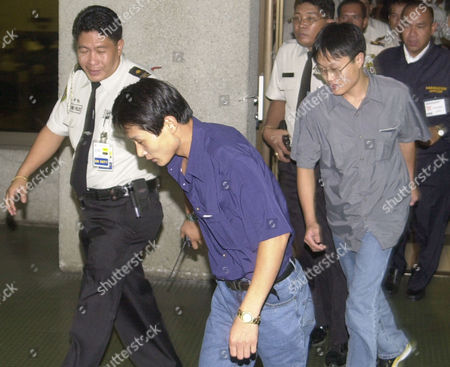 LEE LEE North Korean defectors Lee Soo Chul, 26, left, and Lee Soo Hyuk, 22, are escorted by Philippine police officers at Manila's International Airport, before they board a flight to South Korea, after seeking asylum at the Albanian Embassy in Beijing. Philippine Foreign Affairs Undersecretary Lauro Baja said the Philippine government allowed the defectors to transit for humanitarian reasons following a request from the Albanian Embassy in Beijing. The two men scaled the embassy fence on Tuesday, saying they wanted to go to South Korea