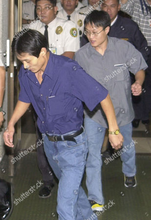 LEE North Korean defectors Lee Soo Chul, 26, left, and Lee Soo Hyuk, 22, are escorted by Philippine police officers at Manila's International Airport, before they board a flight to South Korea, after seeking asylum at the Albanian Embassy in Beijing. Philippine Foreign Affairs Undersecretary Lauro Baja said the Philippine government allowed the defectors to transit for humanitarian reasons following a request from the Albanian Embassy in Beijing. The two men scaled the embassy fence on Tuesday, saying they wanted to go to South Korea