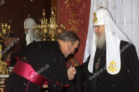 MENNINI ALEXY II Vatican's new top representative in Russia, papal nuncio Archbishop Antonio Mennini, left, greets The head of the Russian Orthodox Church, Patriarch Alexy II during their meeting in Moscow