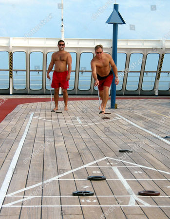 KAPLAN EDWARDS Jeff Kaplan, left, of Leesburg, Va., watches Pat Edwards, of Remington, Va., during a game of shuffleboard aboard the cruise liner, Fascination, as the ship heads back to Miami. Two dozen people aboard the thoroughly-scrubbed cruise ship sailing in the Caribbean reported stomach flu symptoms consistent with a virus that has sickened hundreds of cruisegoers in recent weeks, officials said Thursday