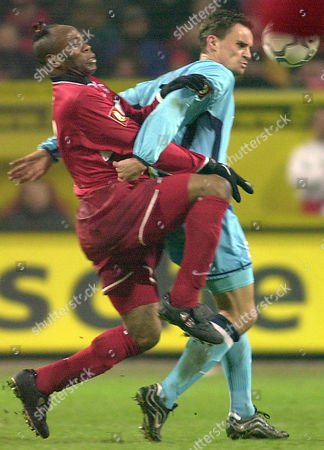 WEST MAX Nigerian Taribo West, left, of 1.FC Kaiserslautern and Martin Max of TSV 1860 Munich fight for the ball during their German first division soccer match Wednesday, Dec 19, 2001 in the Kaiserslautern, western Germany, Fritz-Walter-Stadium