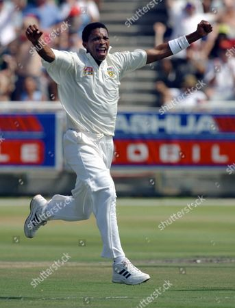 SOUTH AFRICA CRICKET South African bowler Makhaya Ntini celebrates taking the wicket of Mark Waugh on the second day of the second cricket test between South Africa and Australia, played at Newlands Cricket Stadium, Cape Town, South Africa