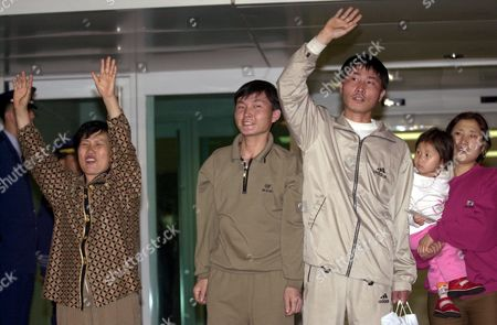 SEEKERS North Korean asylum seekers, from left: Chung Kyung Sook, Kim Sung Kook, Kim Kwang Chul, Kim Han Mi, carried by her mother Lee Sung Hee react after arriving at the Incheon International Airport early . The five landed at the airport, west of Seoul, aboard a Korean Air flight from Manila, Philippines. The North Koreans ran into a Japanese consulate in the northeastern city of Shenyang on May 8 but were dragged out of the consulate grounds by Chinese guards. Their arrest by Chinese police insidethe consulate set off a diplomatic dispute between Tokyo and Beijing