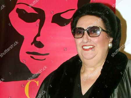 """Spanish opera singer Monserrat Caballe poses for photographers next to the poster of """"Caballe Beyond Music"""", a movie about her life, worldwide released in the 37th MIDEM (International record music publishing and video music market) in Cannes, southern France. Spanish opera star Montserrat Caballe has been given a suspended sentenced of six months in prison for tax fraud, the Catalan regional justice department said Tuesday Dec. 15, 2015"""