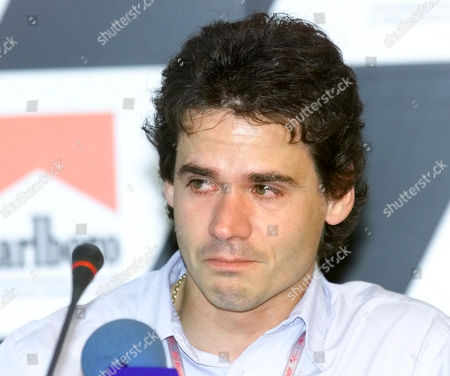 Stock Photo of MOTORCYCLE GRAND PRIX Alex Criville of Spain cries during at press conference where he announced his retirement from the World Motorcycle Championship at the Jerez racetrack in southern Spain, . Criville was hoping to make a comeback after an injury but he confirmed his retirement