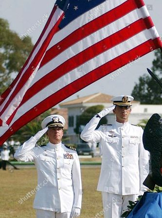 CROWN PRINCE FELIPE Spain's Crown Prince Felipe, right and U.S. naval commander Richard Noble salute beneath an American flag at the joint Spanish/U.S. Rota naval base, southern Spain, . A military cememony was held in honor of the victims of the recent terrorist attacks on the United States